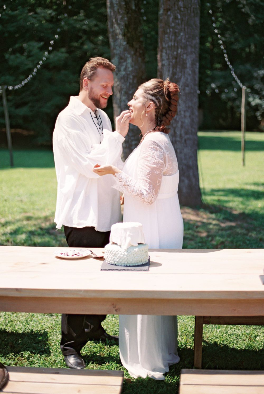 Couple feeding each other cake
