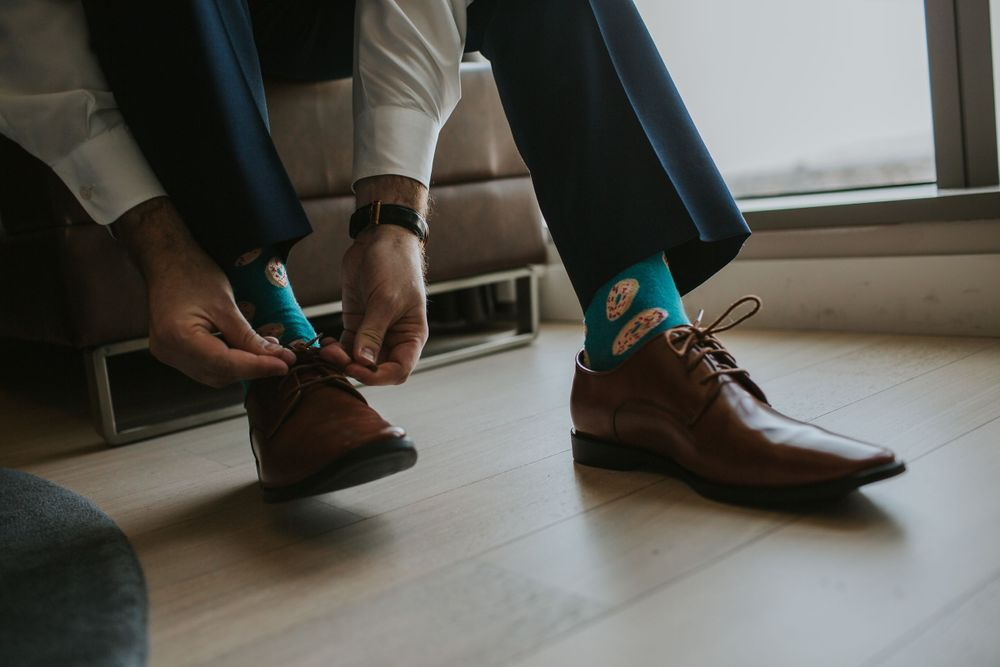 groom tying shoes close up