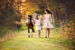 plymouth child photographer | heidi harting | two girls in summer dresses walking their pony