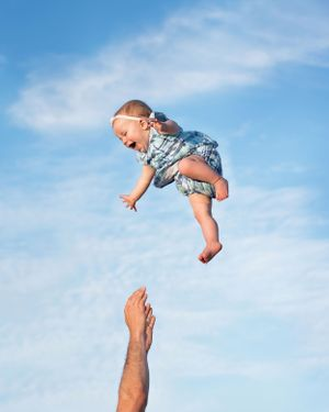 plymouth, ma child photographer | heidi harting | adorable baby girl wearing vineyard vines being tossed in the air