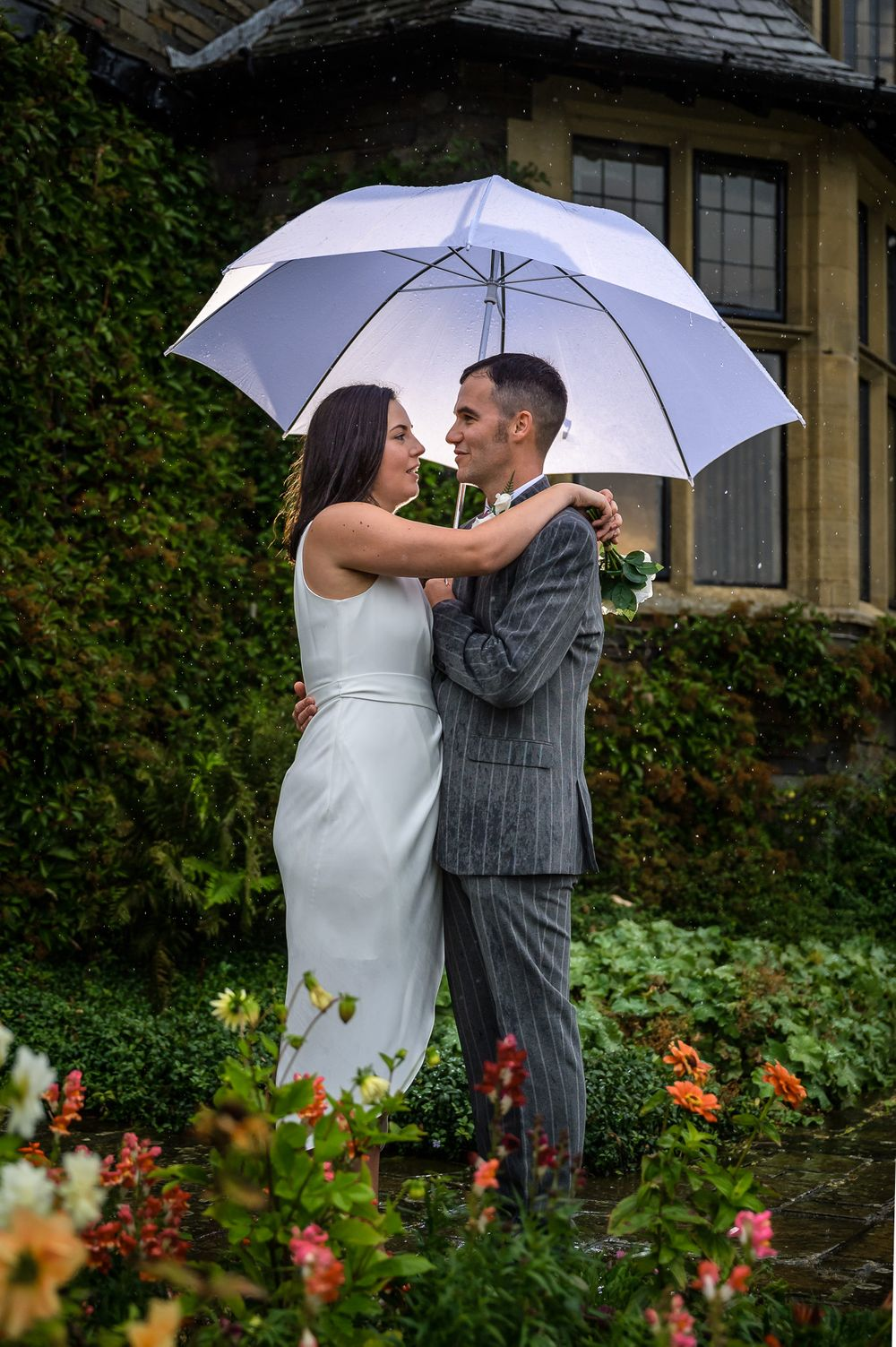 Bride and groom under umbrella at Cragwood Country House Hotel