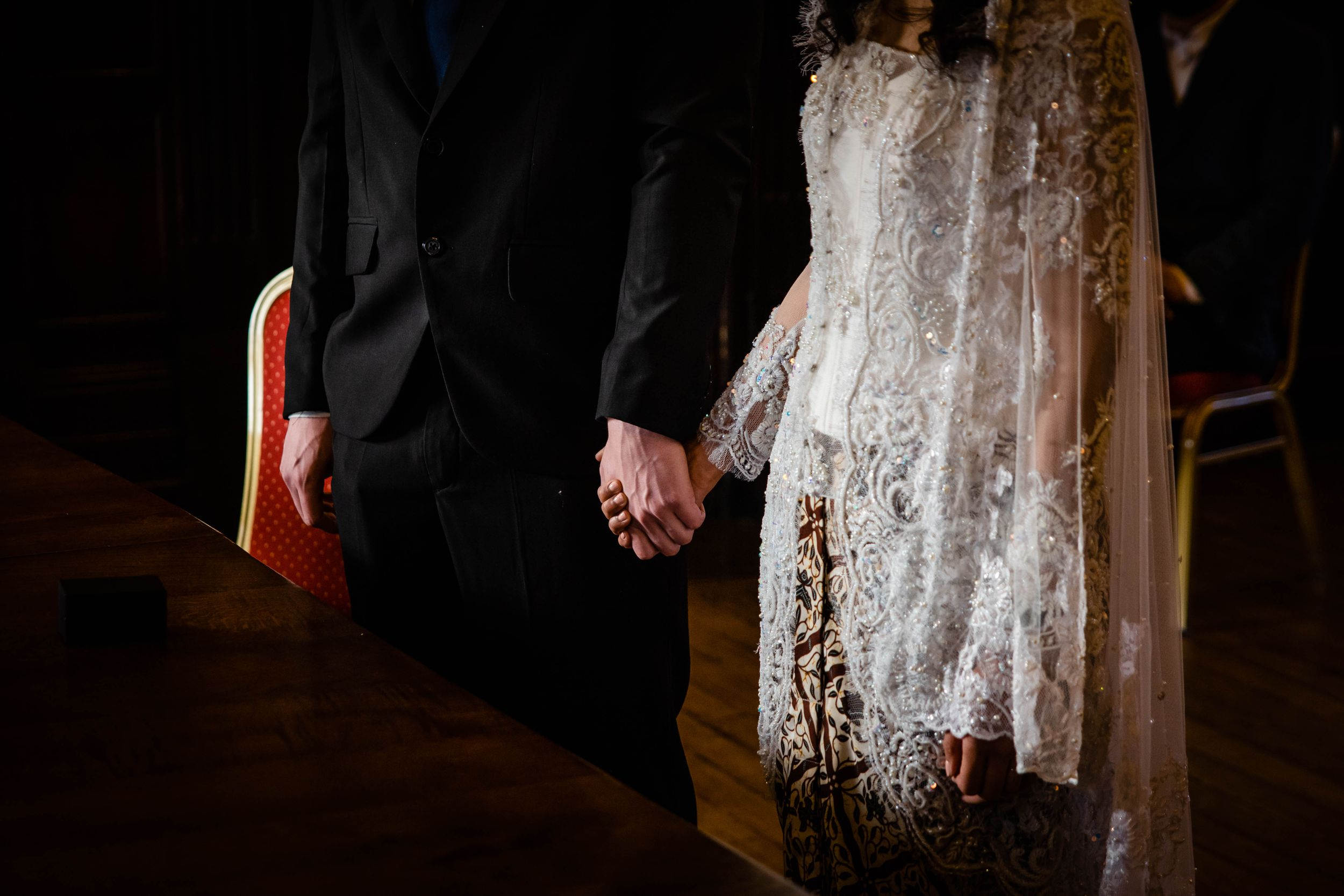 Zara Davis Wedding Photography Hereford Town Hall holding hands