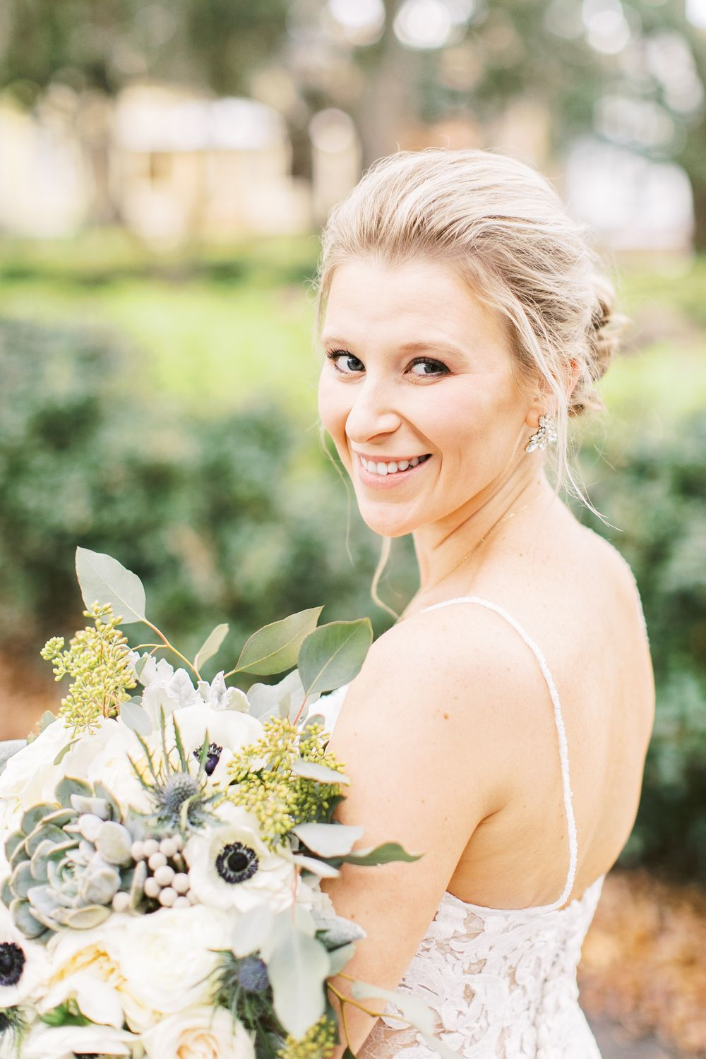 kayley taking bridal portraits on her wedding day in savannah, ga