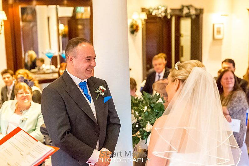 groom smiling at the bride looking embarrassed for crying during the ceremony at the mercure hotel haydock