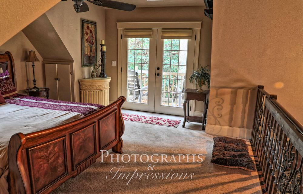 real estate photograph of loft room by Photographs and Impressions and Nunweiler Photography