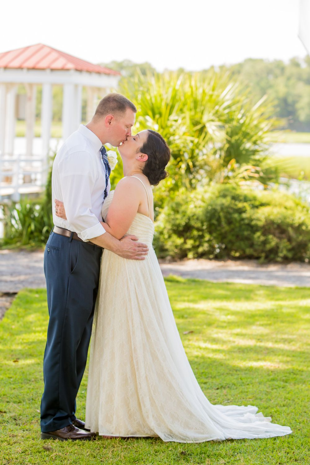 Bride Clare and groom Curtis kiss following their wedding ceremony at I'On Club in Mt. Pleasant, SC