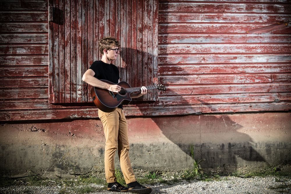 Guitar, barn, birkenstocks