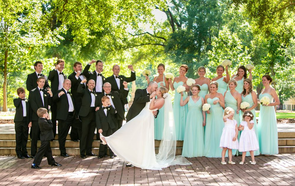 Maggie and Bryan pose with their bridal party on the USC Horseshoe in Columbia, SC. Photo by photographer Jeff Blake.