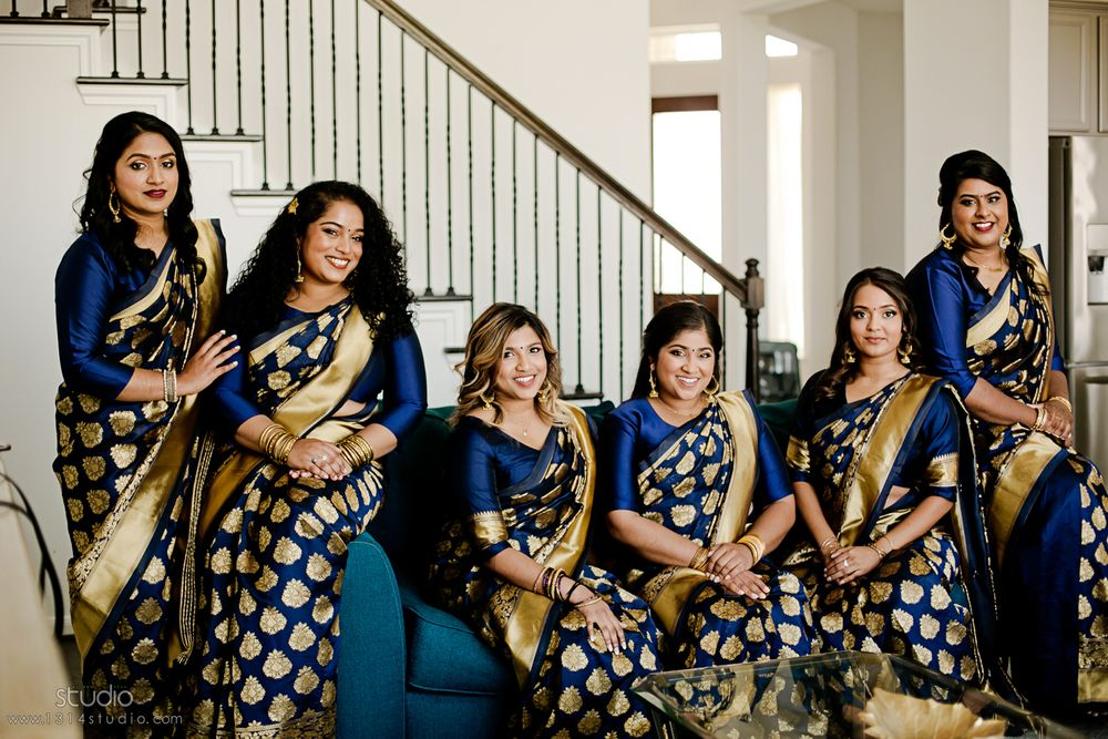 indian bridal party in royal blue and gold dresses