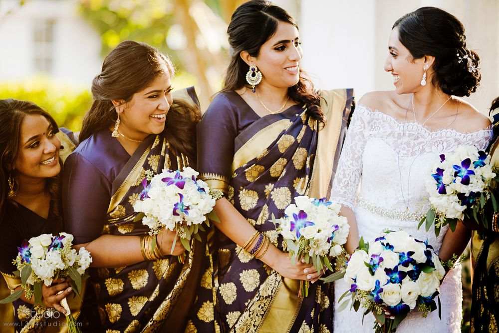 beautiful bride and her girls in blue and gold dress