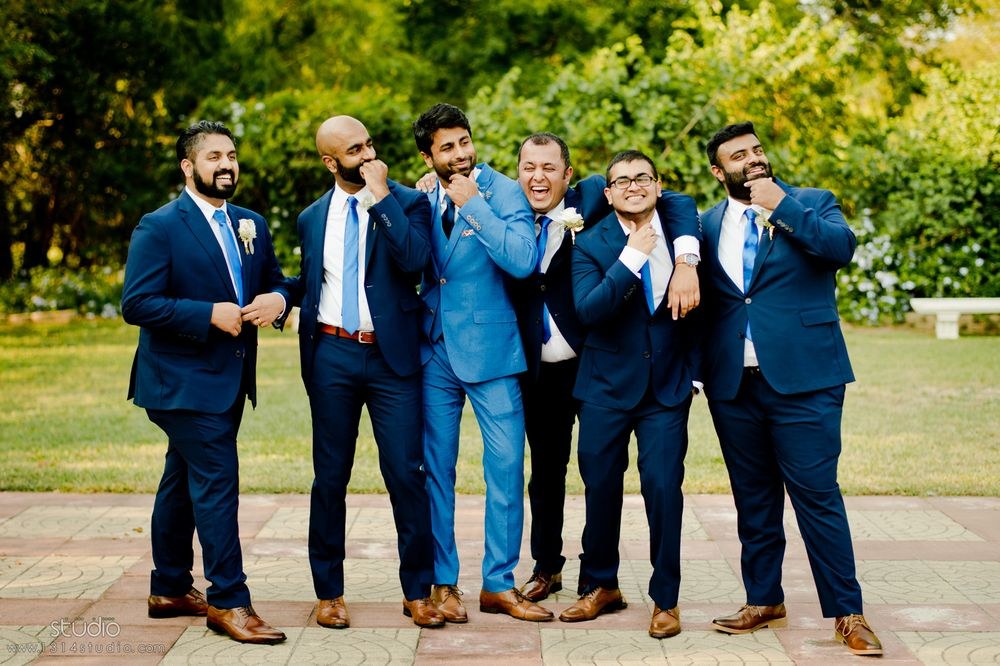 indian bridal party in royal blue outfits with flower prints