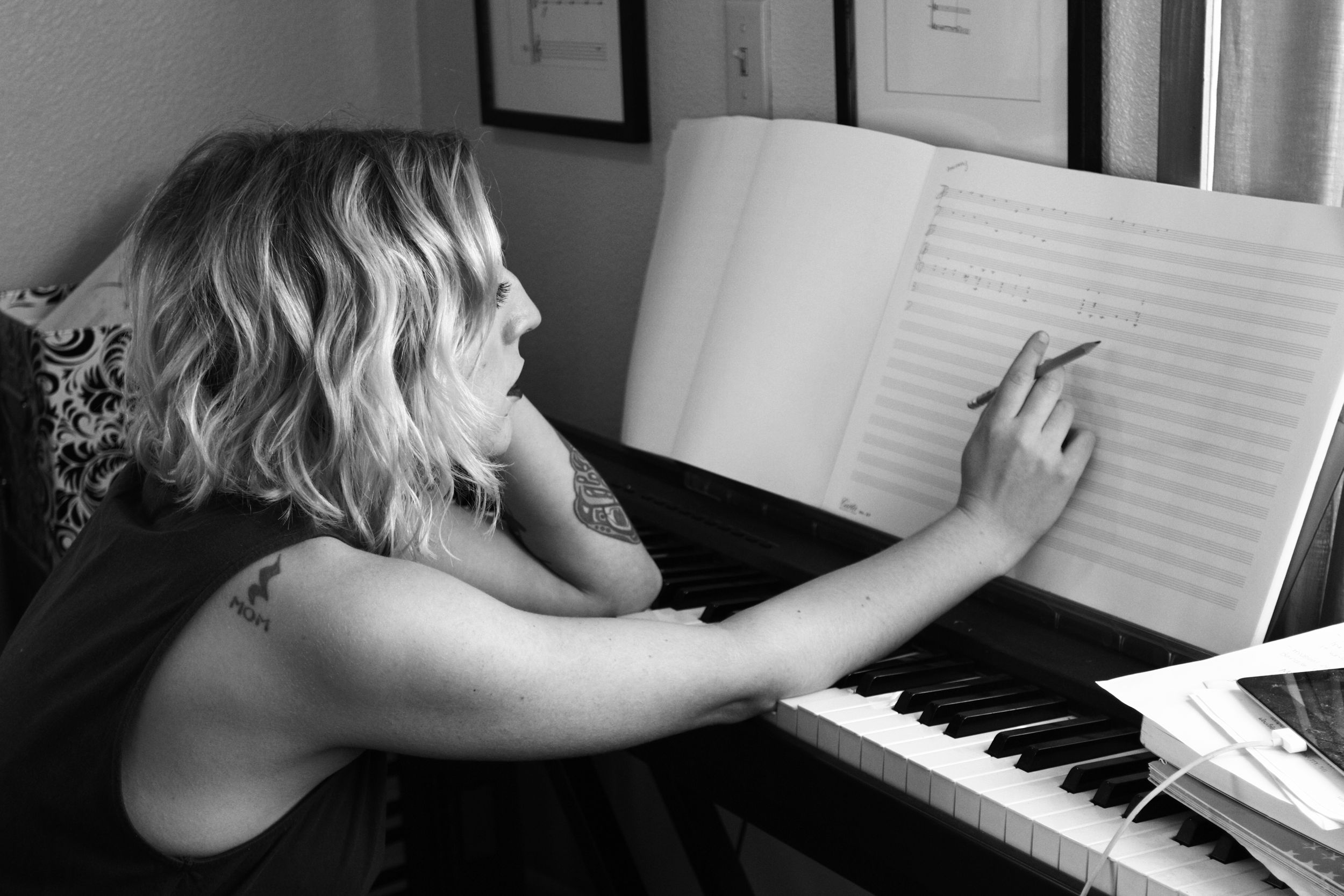 Composer Kaley Lane Eaton at her piano, working on a new project.