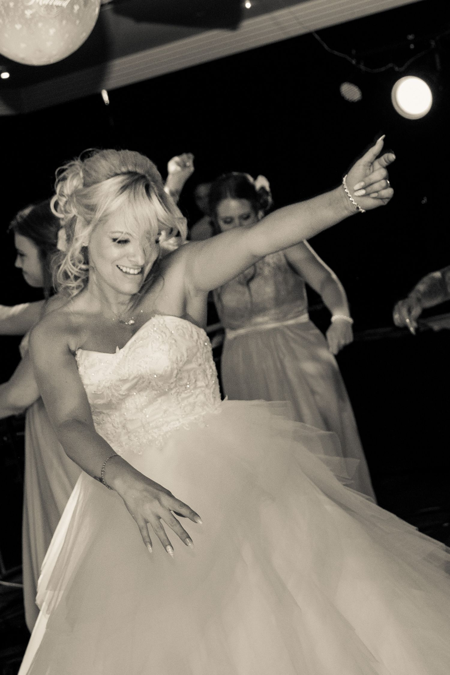 bride enjoying herself on the dance floor at the hallmark hotel warrington
