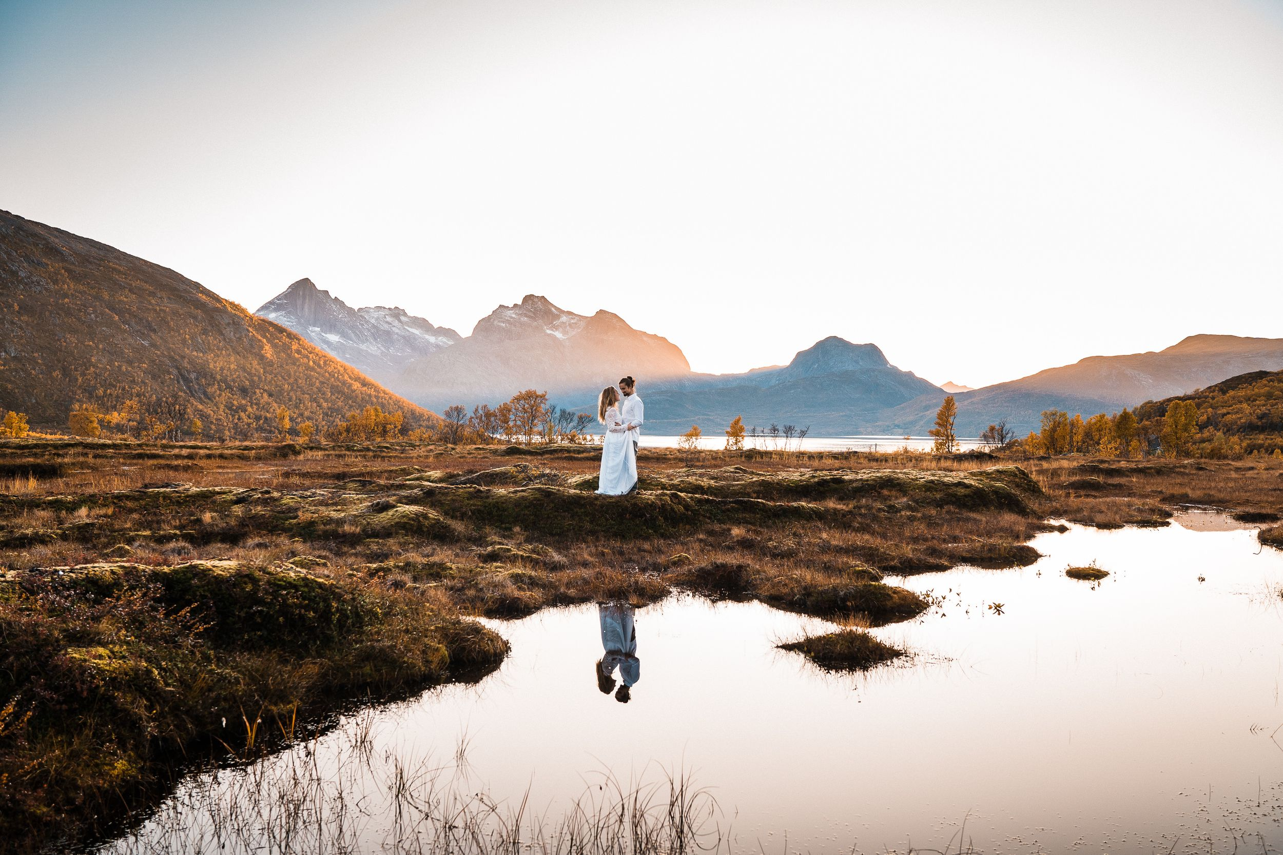 Photographer Maria Karlsson Swedish Adventure Elopement Couple and mountains in tromsö norway norge Bridal gown