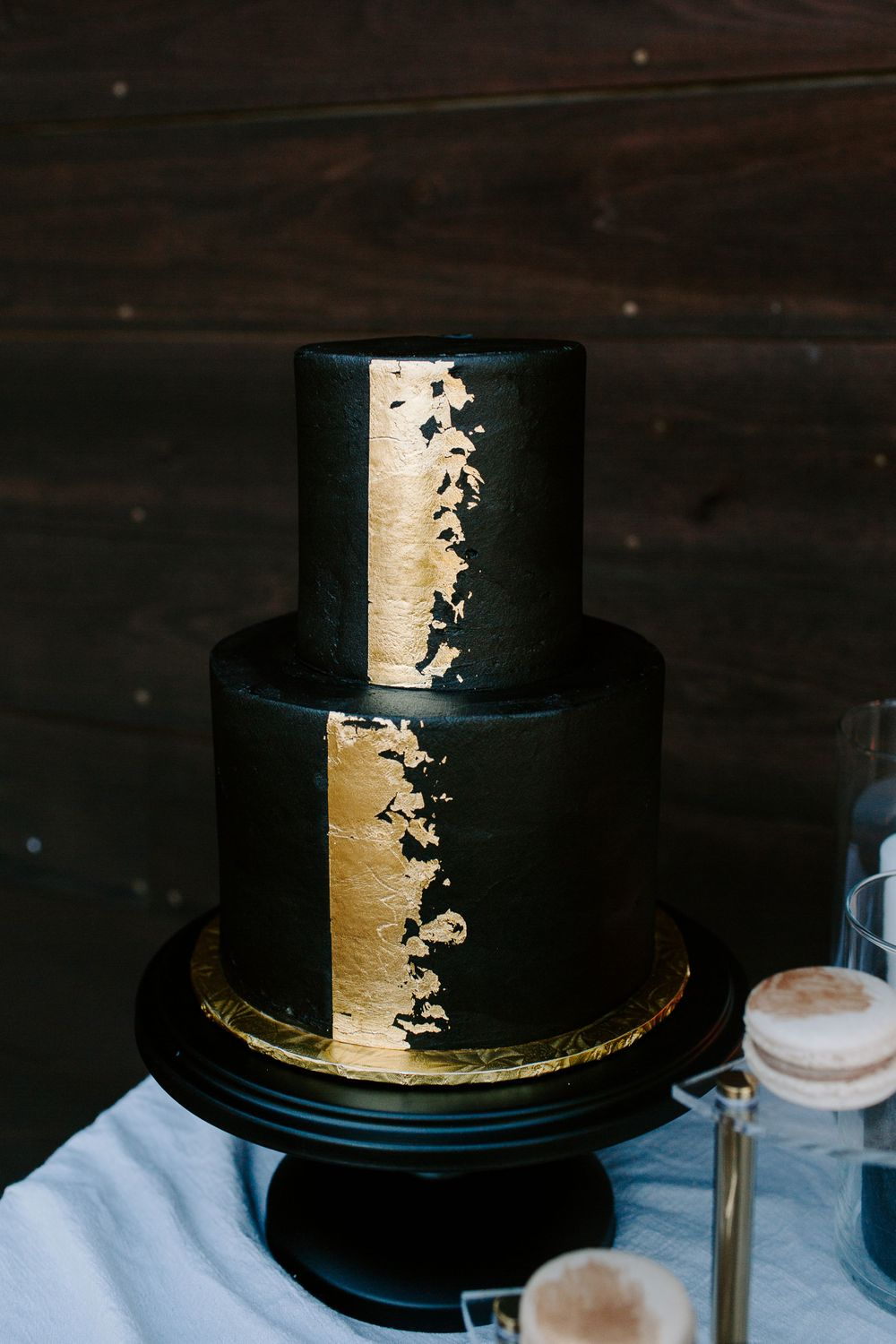 gold and black three layer cake from elopement