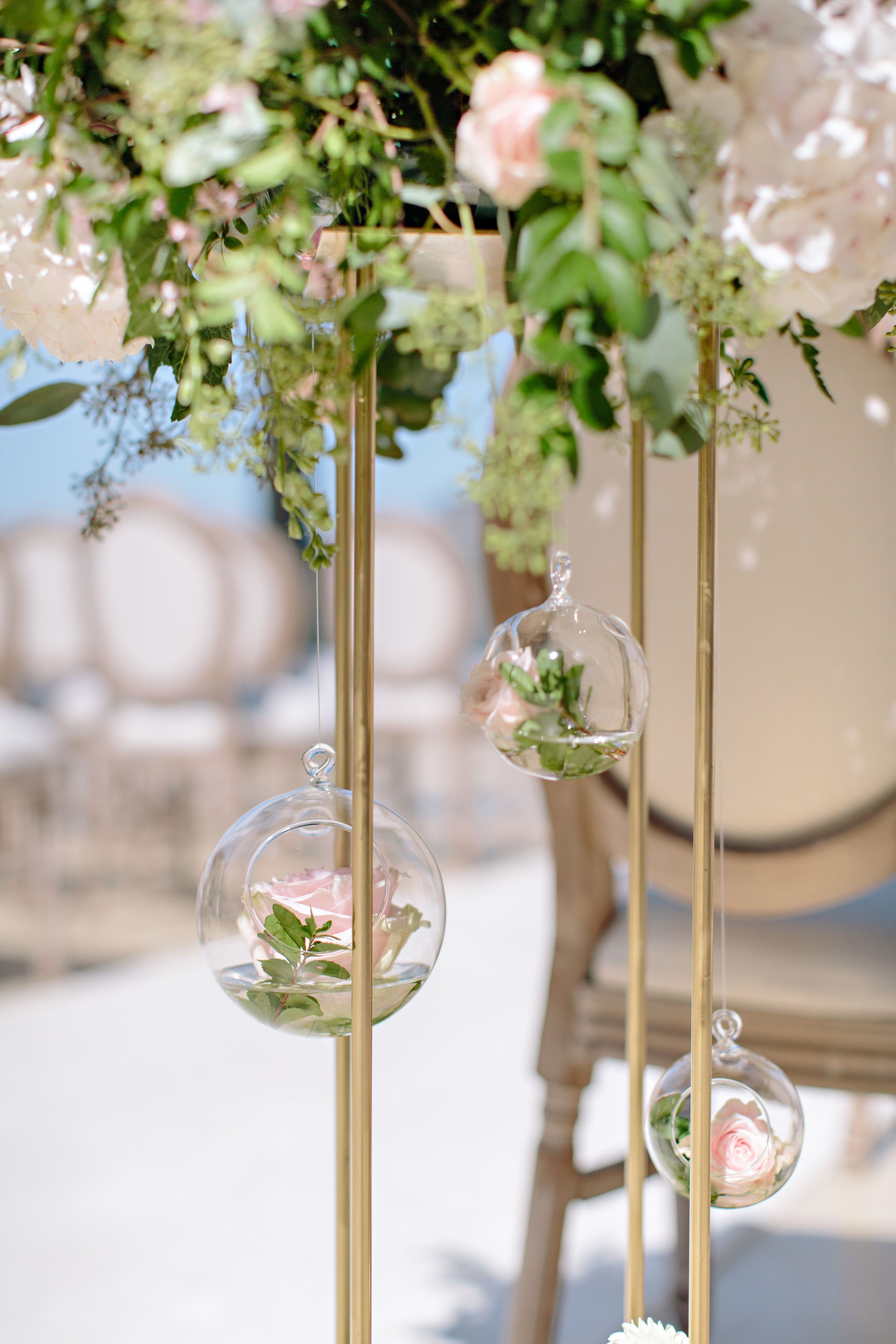 hanging glass vase at wedding ceremony