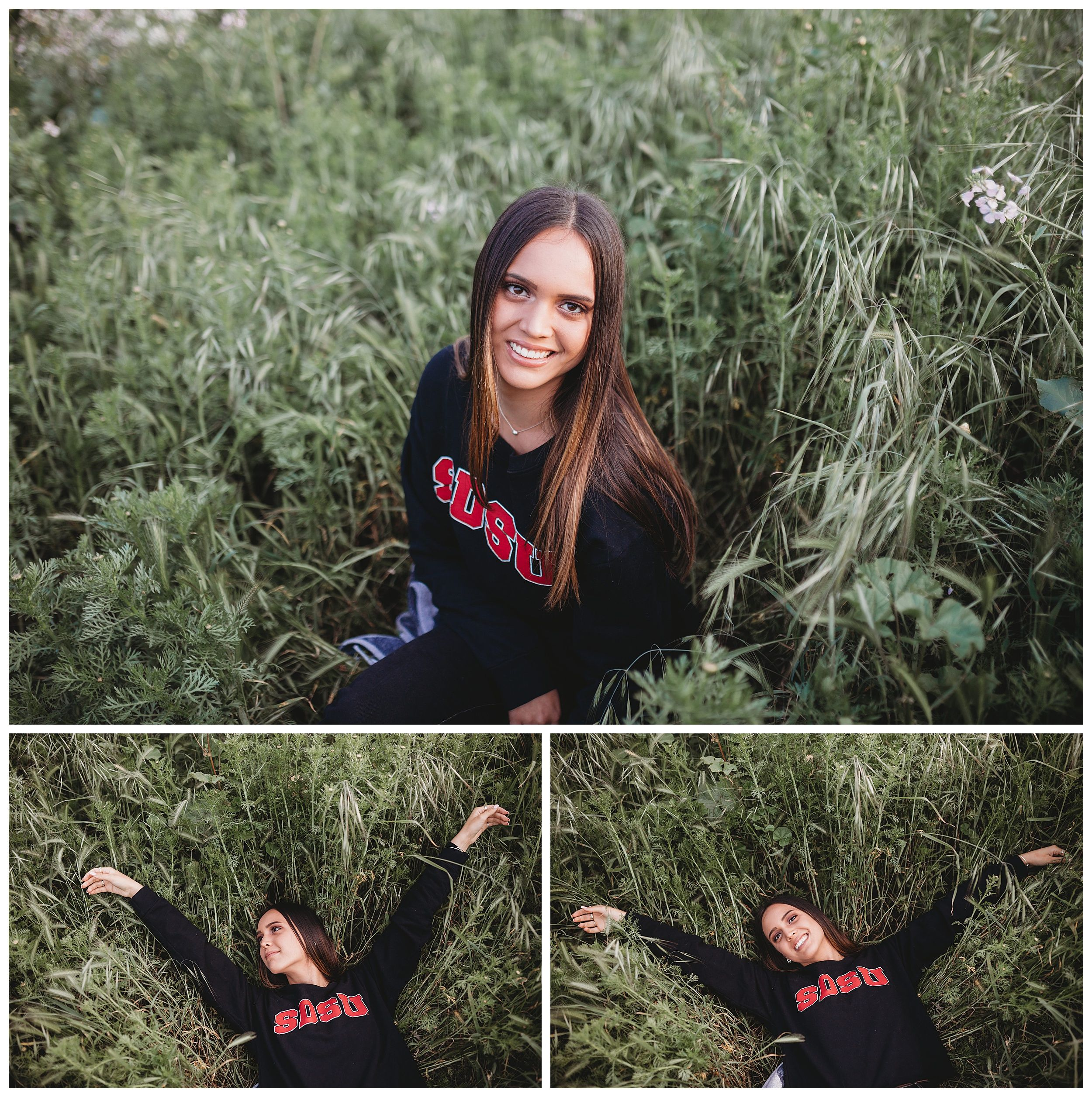 girl sitting in field with college sweatshirt