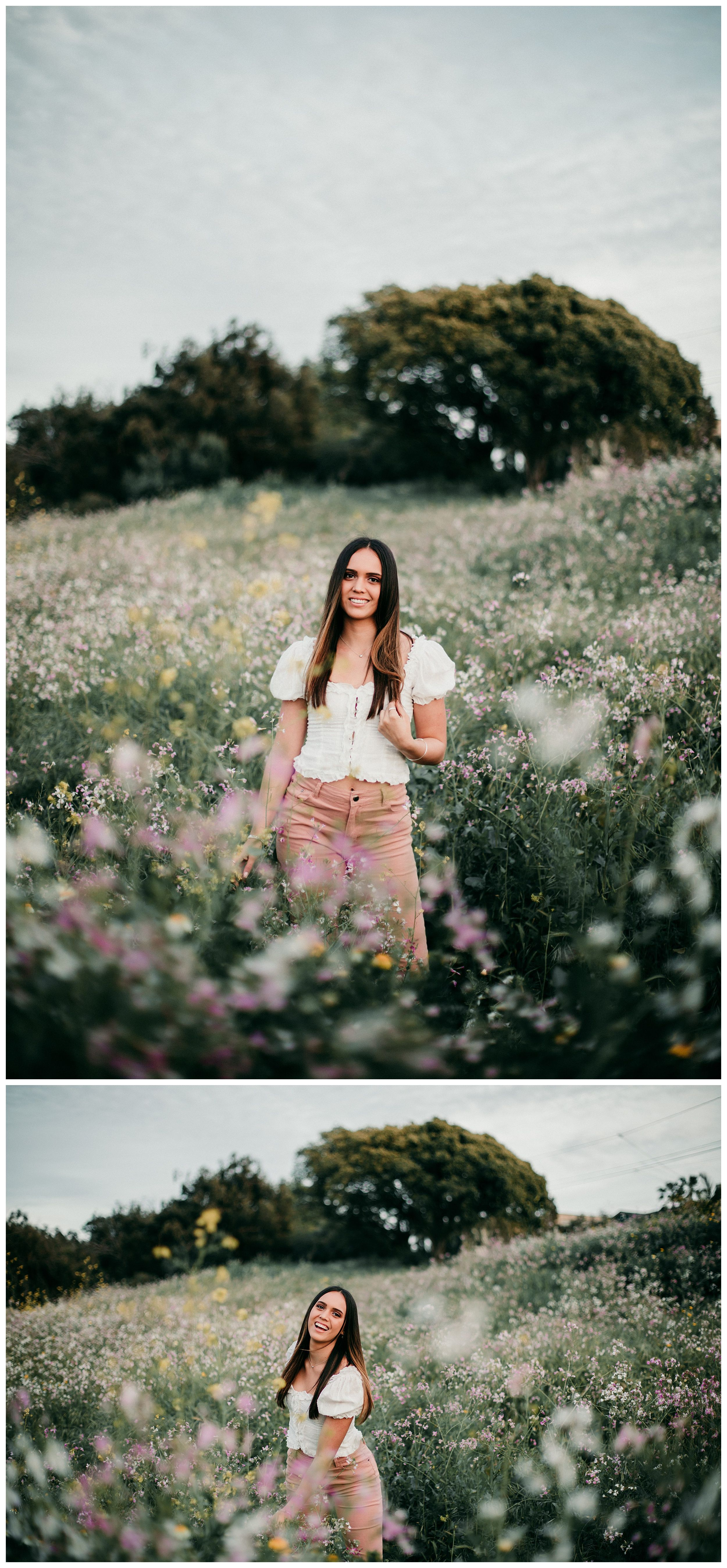 girl standing and smiling in flower field