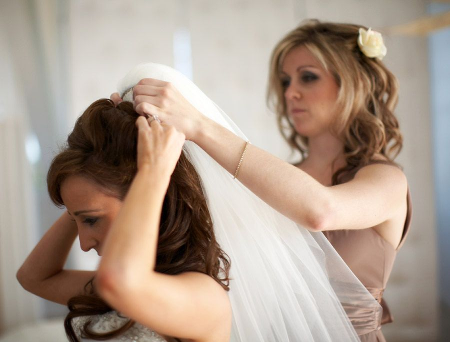 The bride getting helped with her veil at Belle Mer in Newport Rhode Island