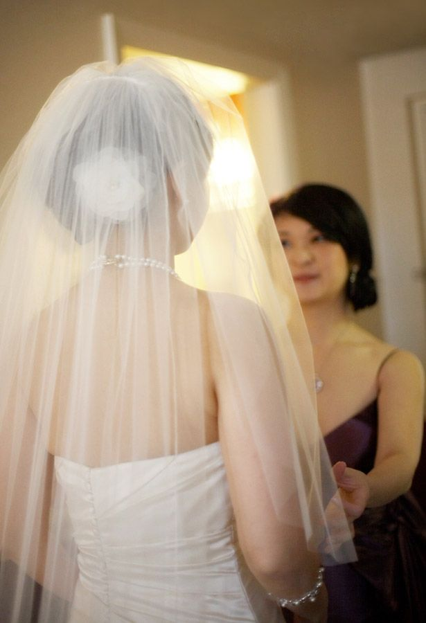Sister of the bride helping her get ready on her wedding day at the Hotel Viking in Newport Rhode Island
