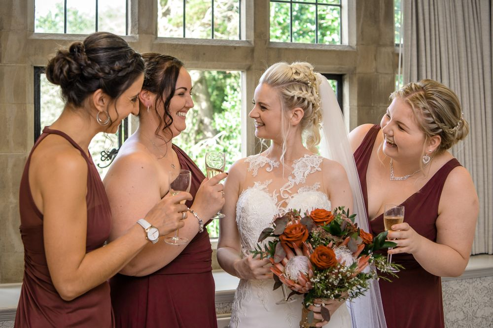 Bride with bridesmaids before wedding at Cragwood Hotel