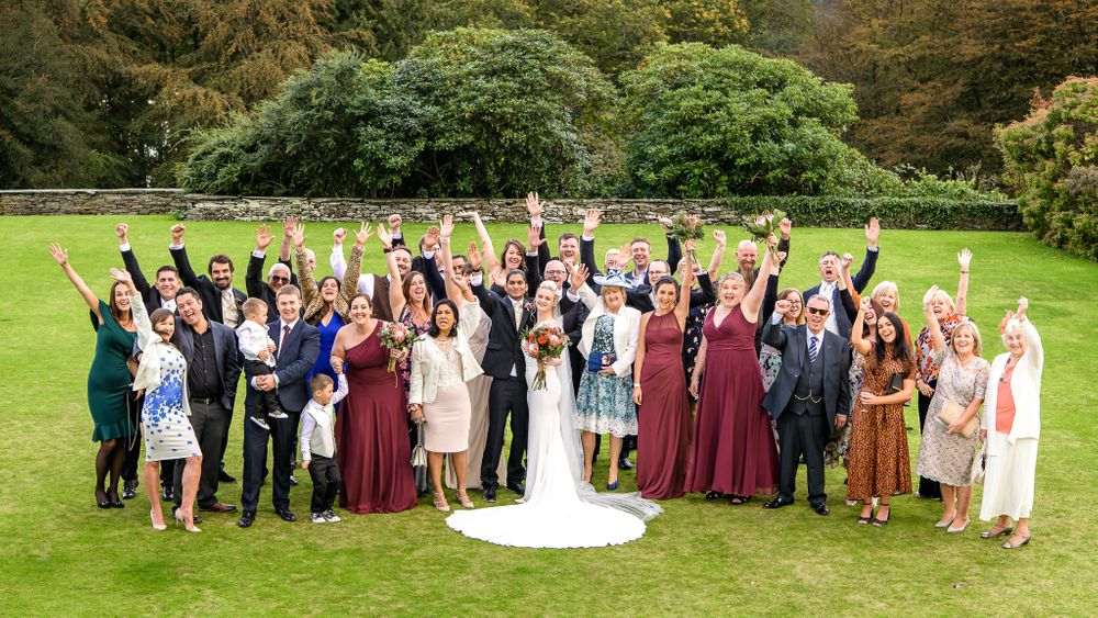 Bride and groom with guests on lawn at Cragwood Hotel