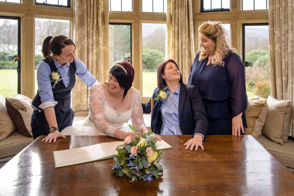 Two brides with their witnesses at Cragwood wedding