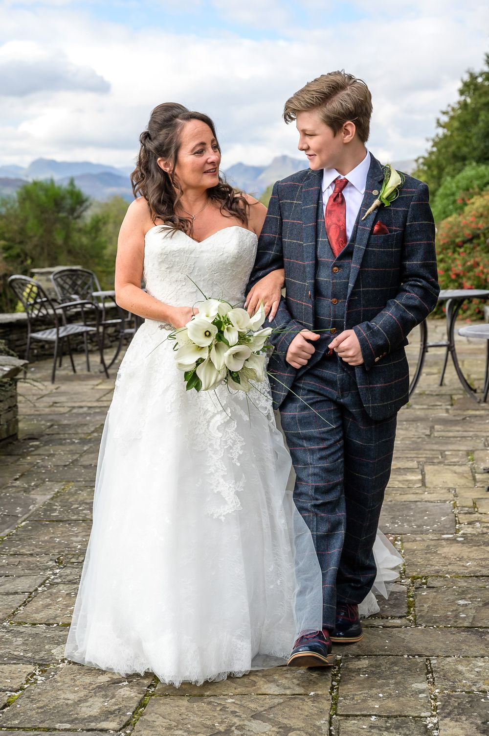 Bride and her son on terrace at Cragwood wedding