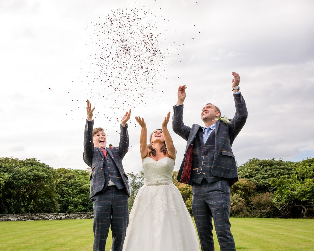Family throwing confetti in air at Cragwood wedding
