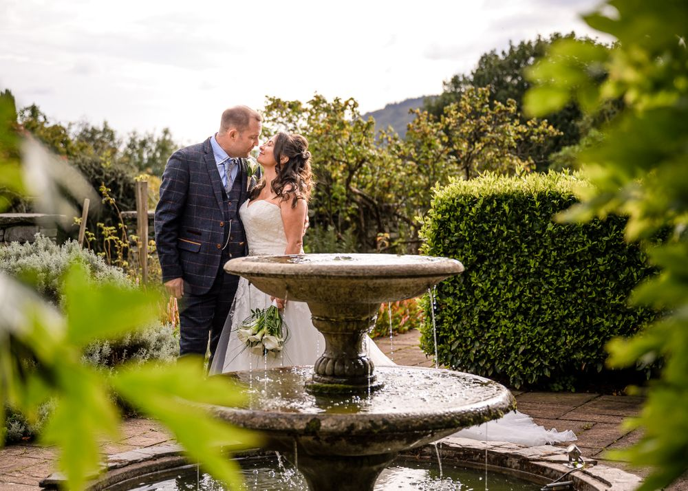 Bride and groom by fountain at Cragwood Country House Hotel