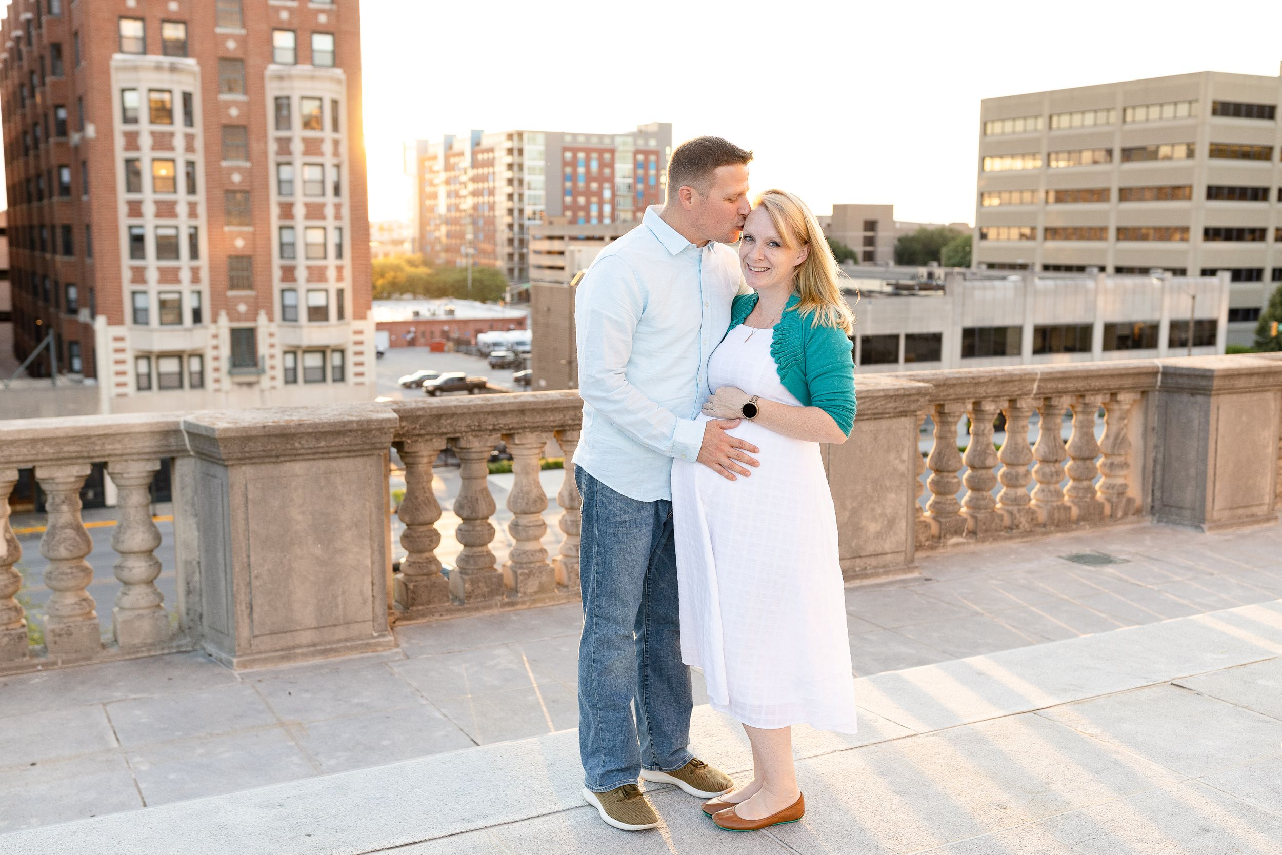 portrait of pregnant mother with husband on rooftop