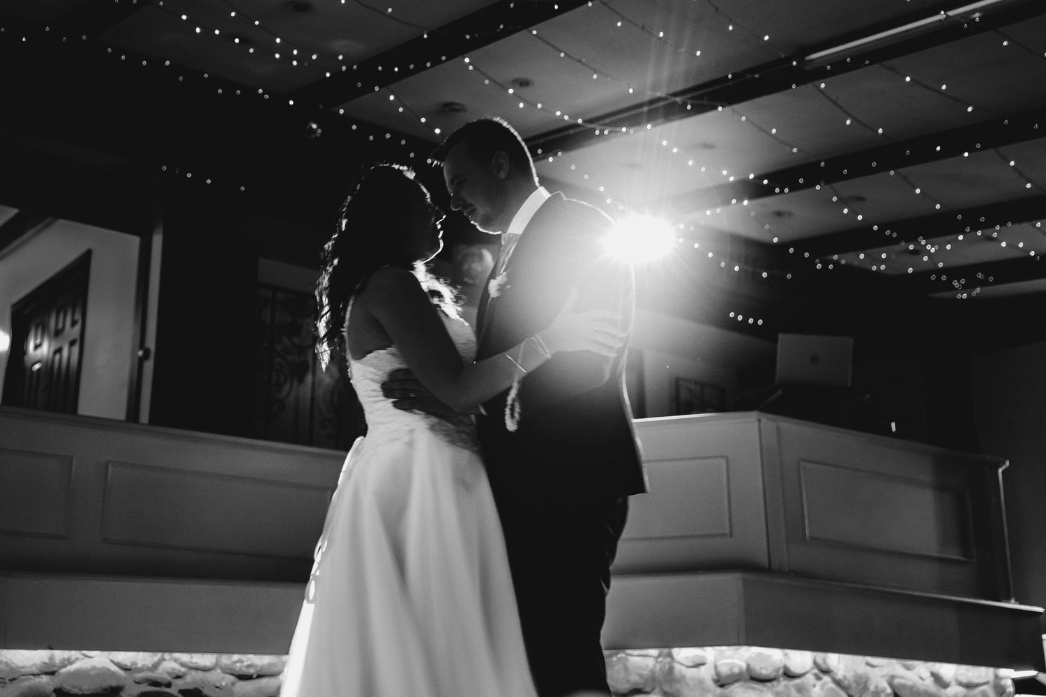 Bride and groom first dance in spotlight chateau wyuna melbourne wedding