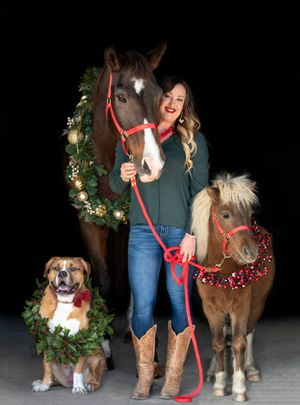 Holiday photo of woman her dog and horses
