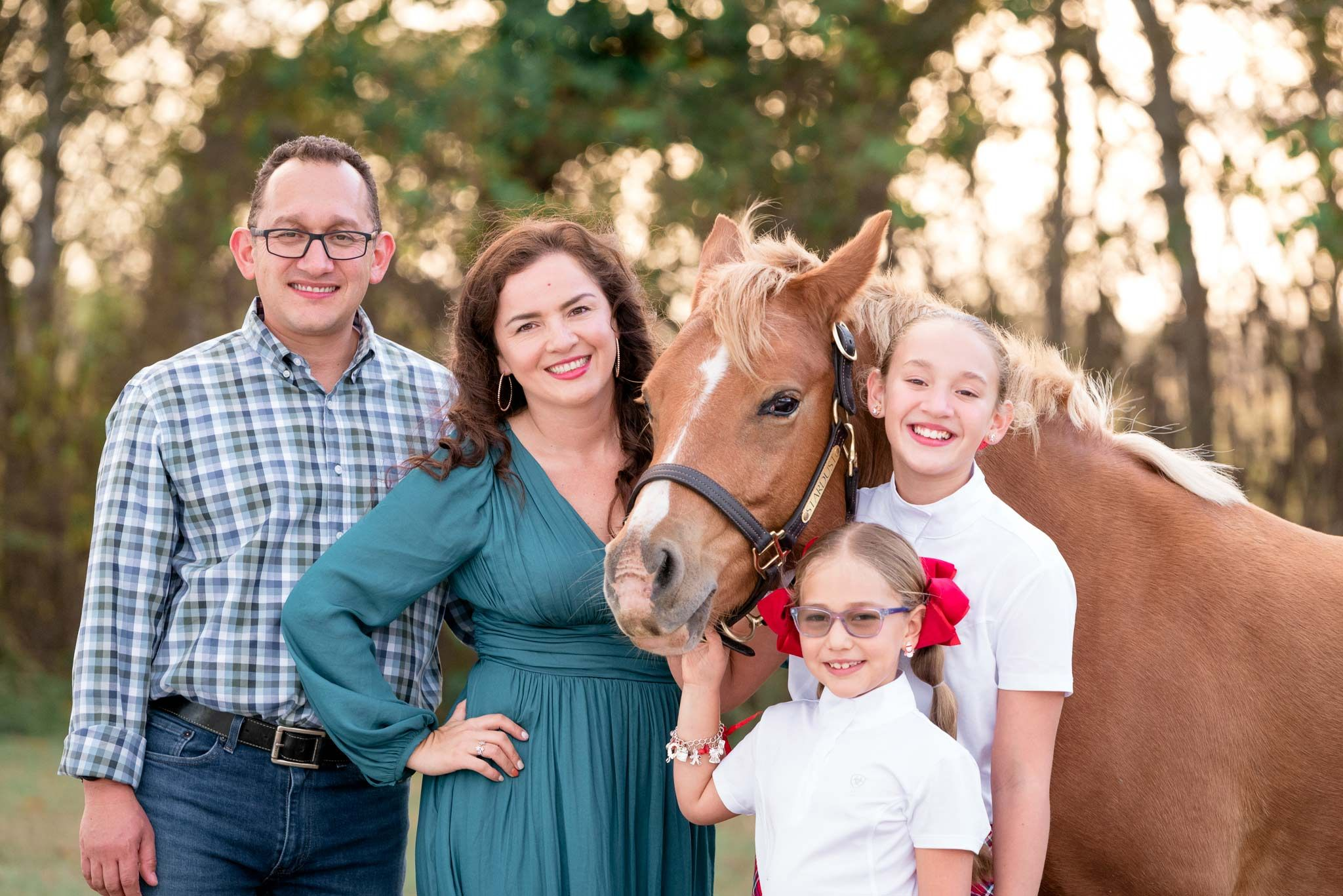 Family portrait with horse at sunset houston