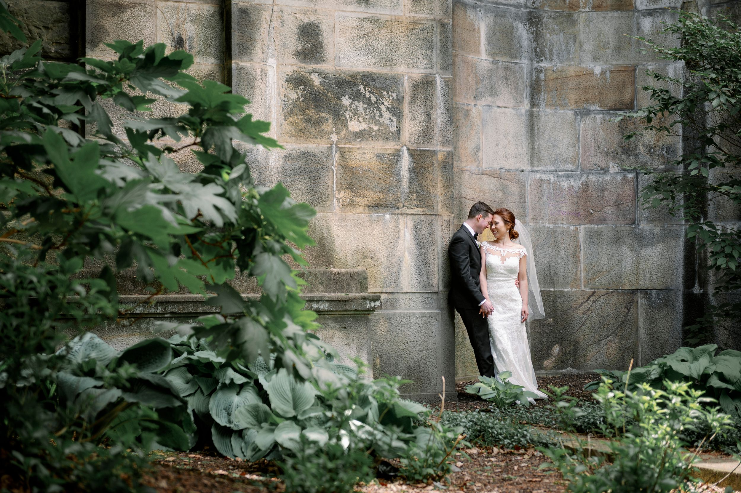 Intimate and dramatic wedding photo of bride and groom nuzzling at the Philadelphia Art Museum.