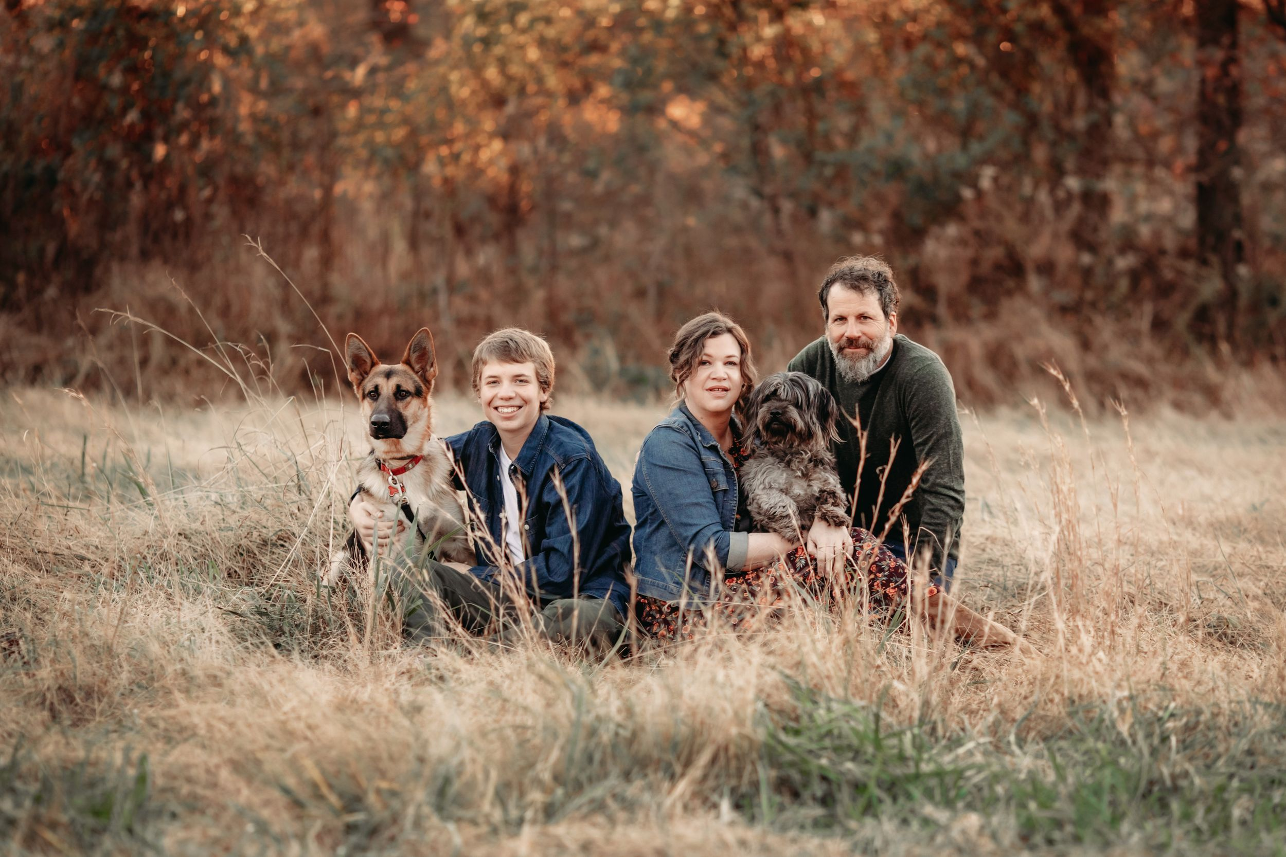 a photo of Shawn Sawyer's family and her dogs