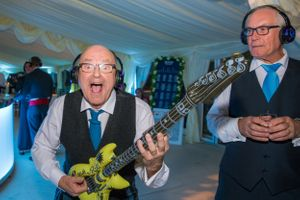 old man playing with inflatable guitar, Robert Nelson Wedding Photography