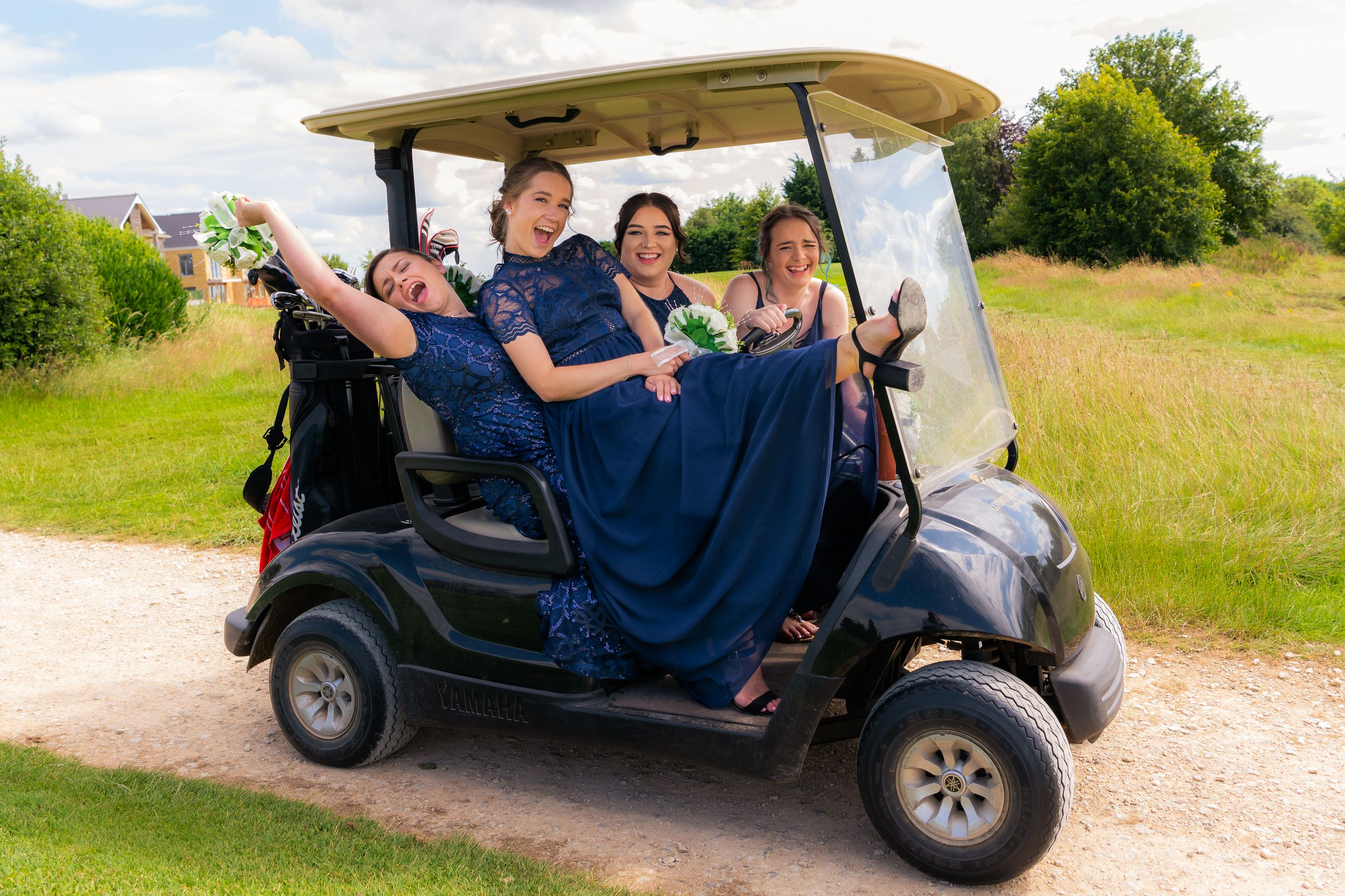 brides maids on the golf buggy, Robert Nelson Wedding Photography