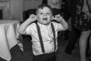 young page boy holding his ears, Robert Nelson Wedding Photography