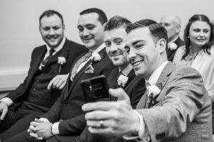 grooms men taking a selfy, Robert Nelson Wedding Photography