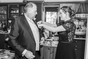 father of the bride having his button hole fitted, Robert Nelson Wedding Photography