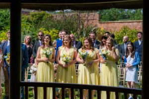 brides maids look at the wedding through and outdoors gazebo, Robert Nelson Wedding Photography