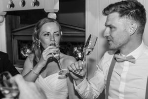 bride winks at groom with champaign, Robert Nelson Wedding Photography