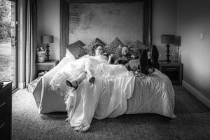 bride and groom jumping on the bed - Aubrey Park Hotel St Albans