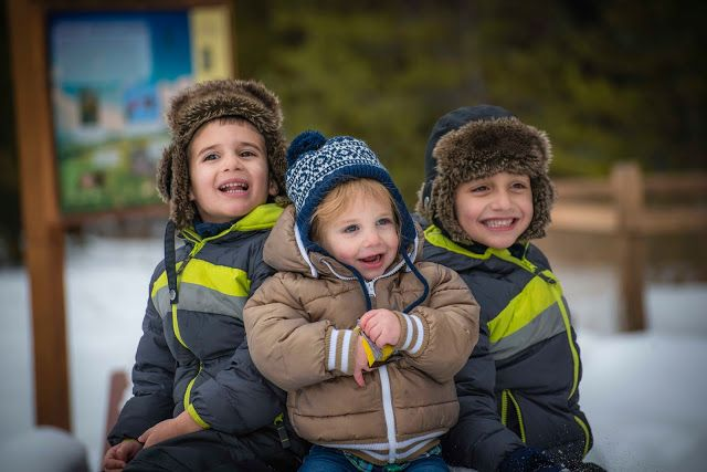Three little boys in winter clothes a the Vail Nature Center