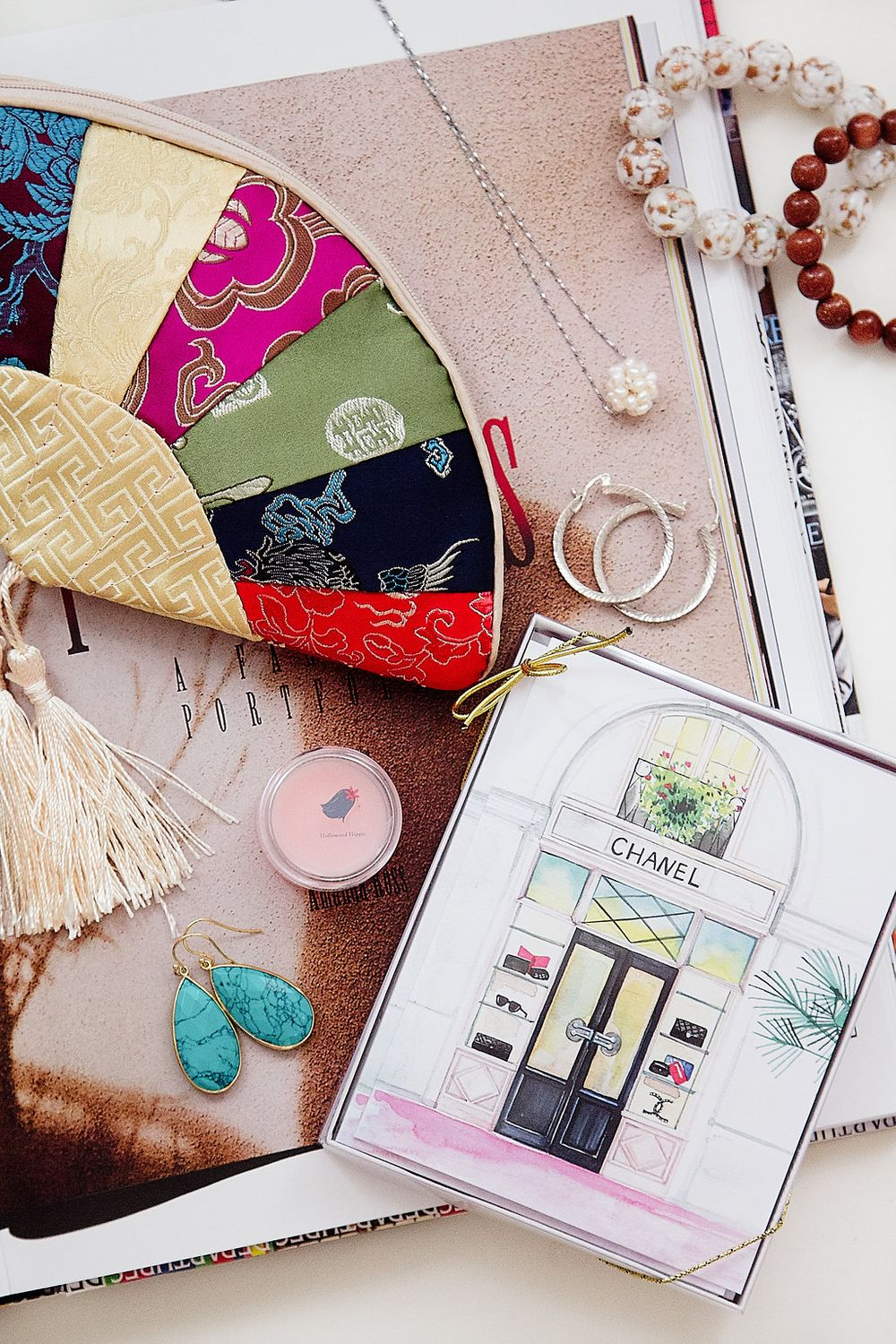 Flat-lay photography of boutique items and magazine