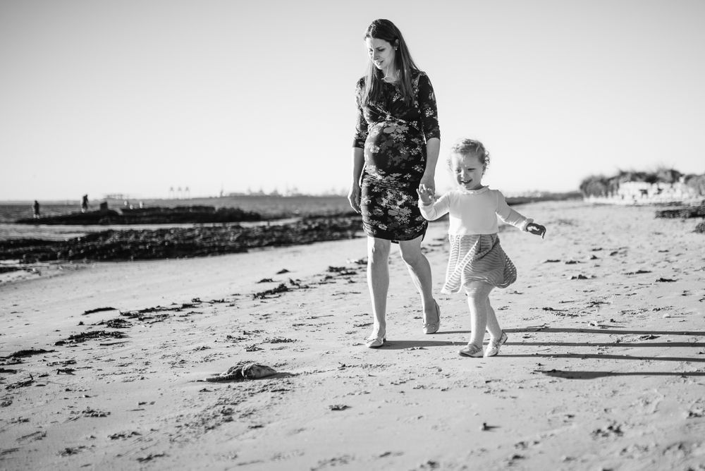 toddler with mother at the beach