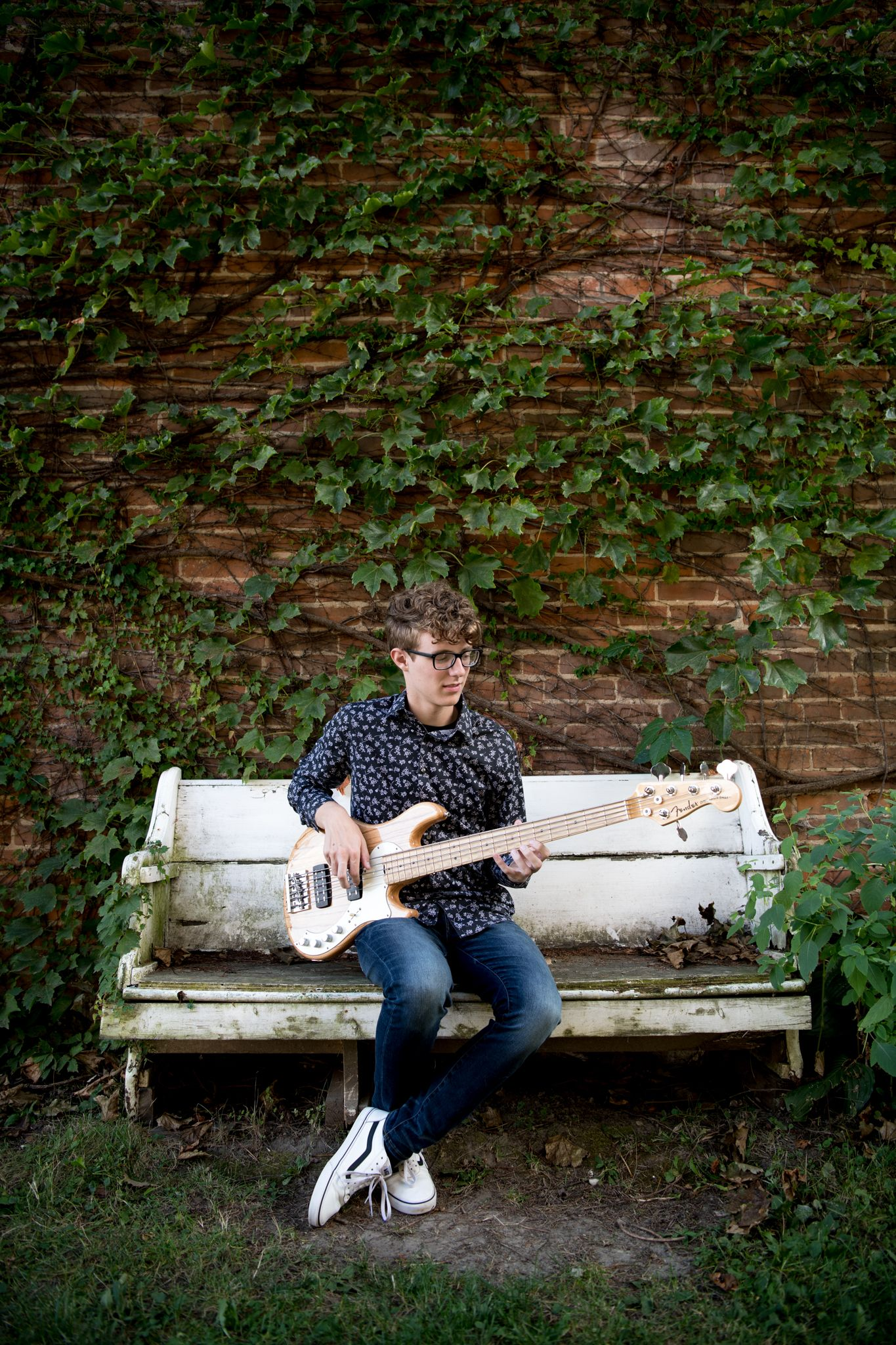 Ivy wall, old bench, guitar, brick wall, jeans, patterned shirt