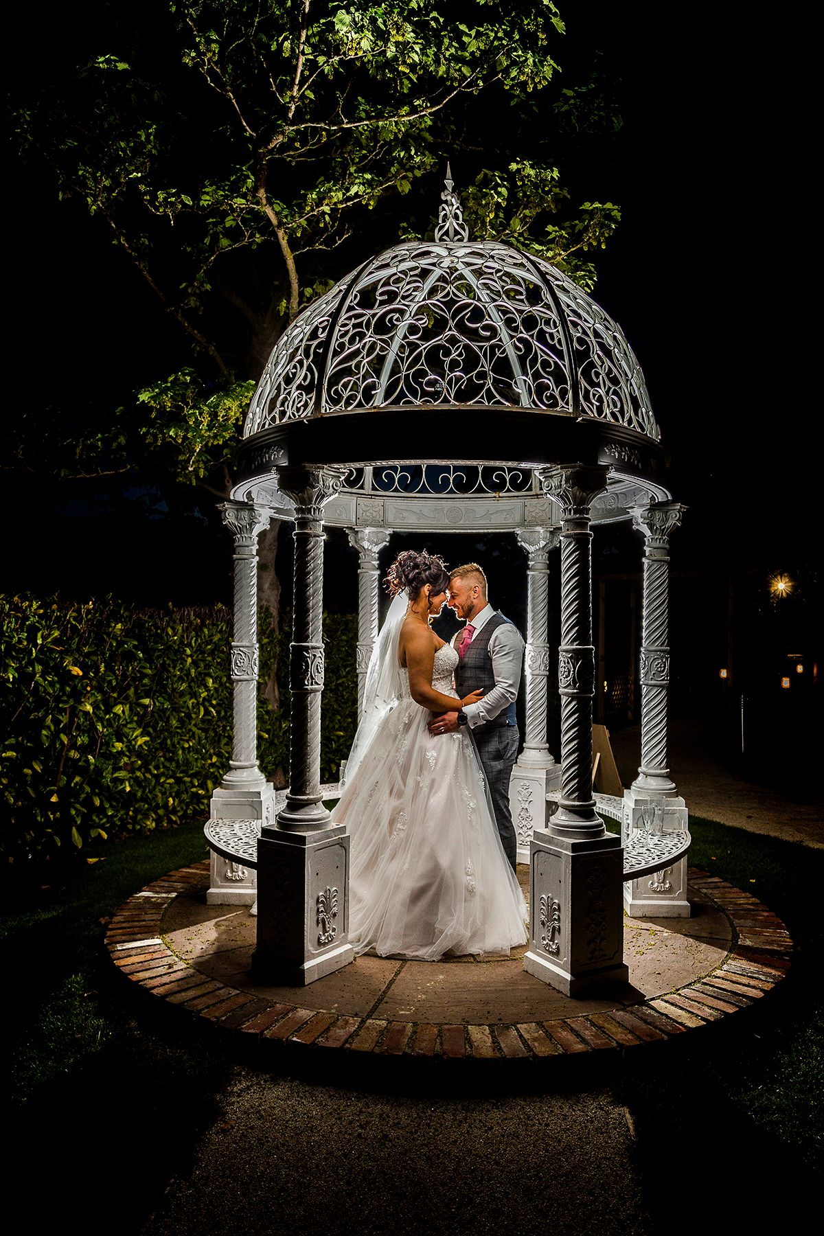 bride and groom under an ornate gazebo at the Nottinghamshire golf club