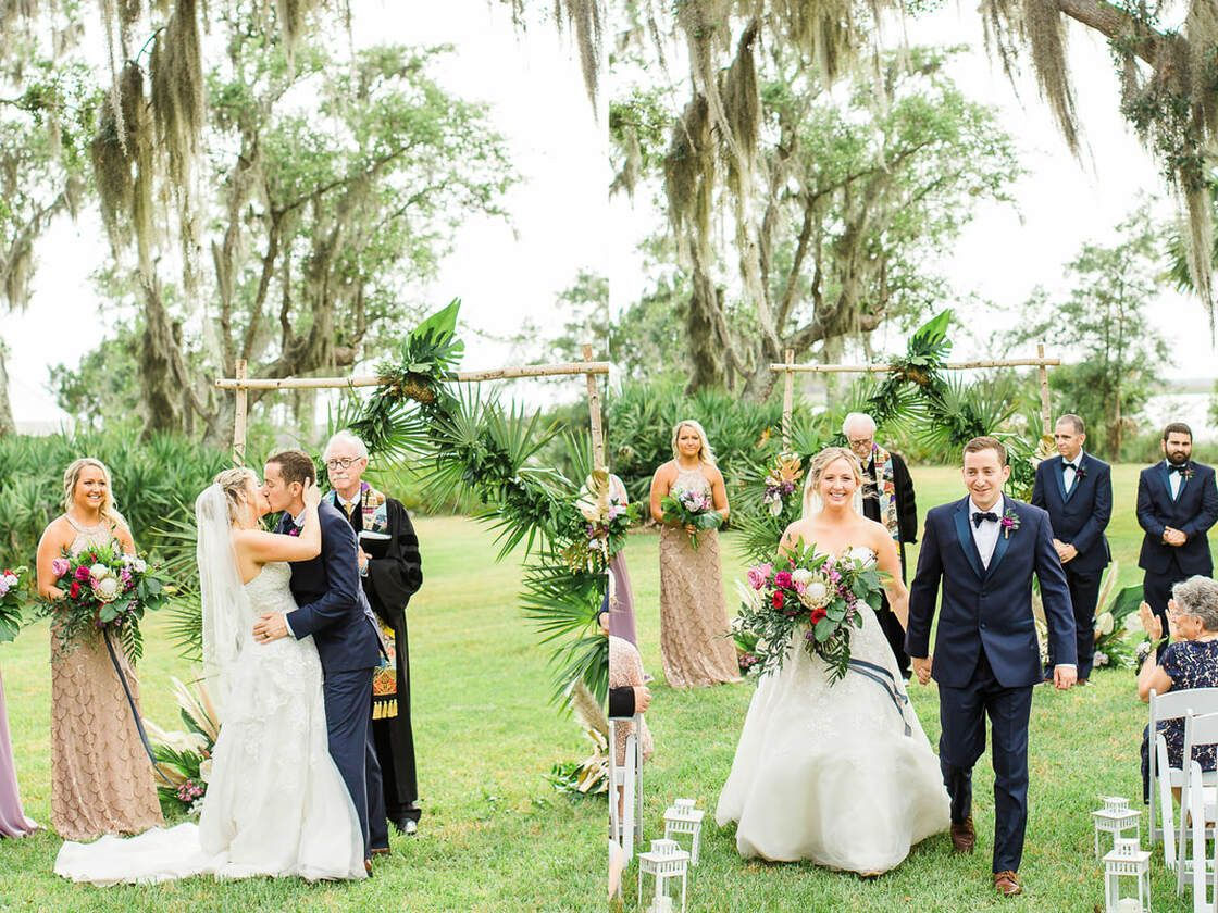bride and groom share first kiss after wedding ceremony